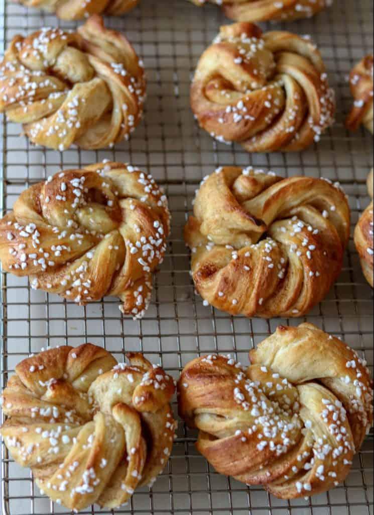 Swedish cinnamon buns on a cooling rack