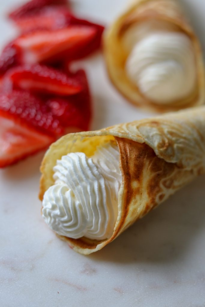 Krumkake with whipped cream and strawberries