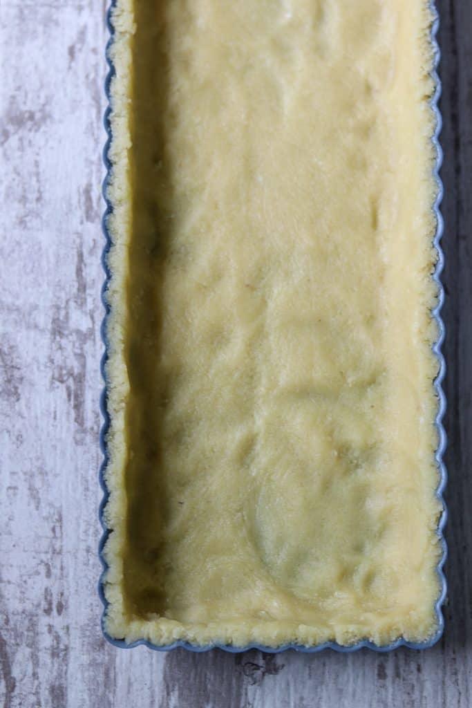Tart dough in a pan