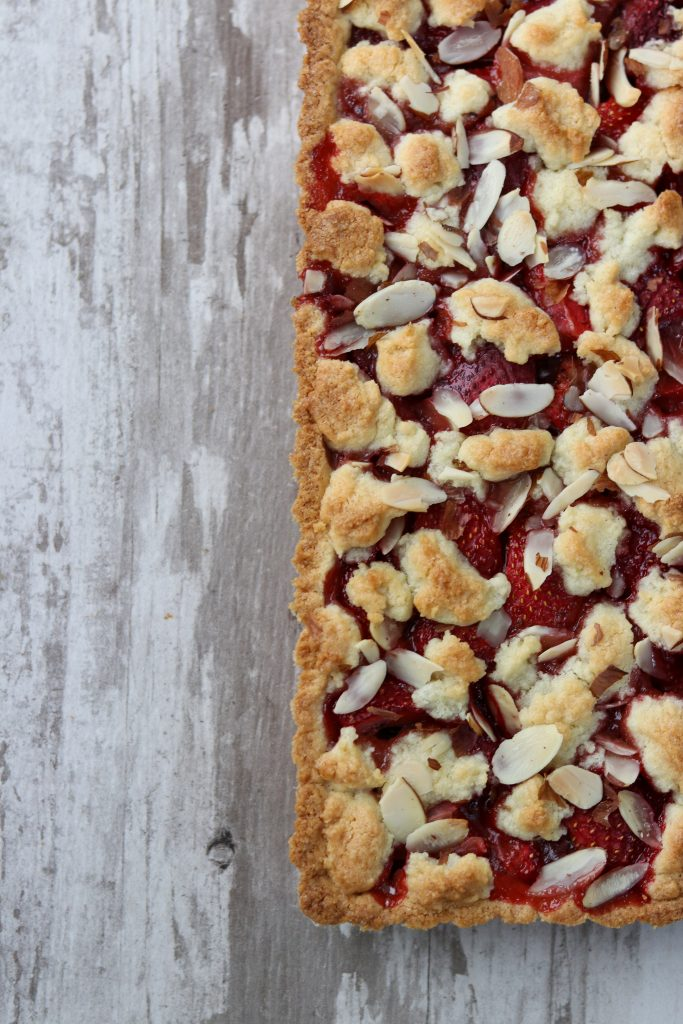 Strawberry almond tart on a wooden surface