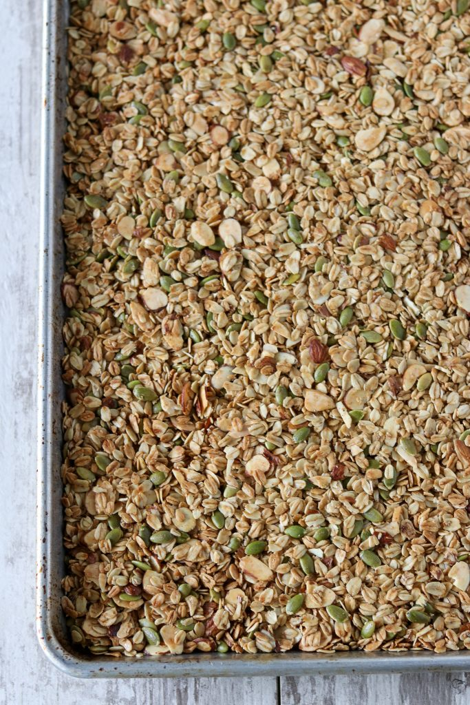 A baking sheet filled with baked granola