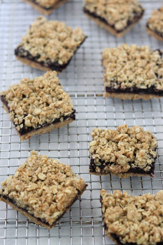 Blueberry crumble bars on a cooling rack
