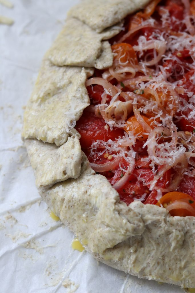 Closeup of an unbaked tomato tart