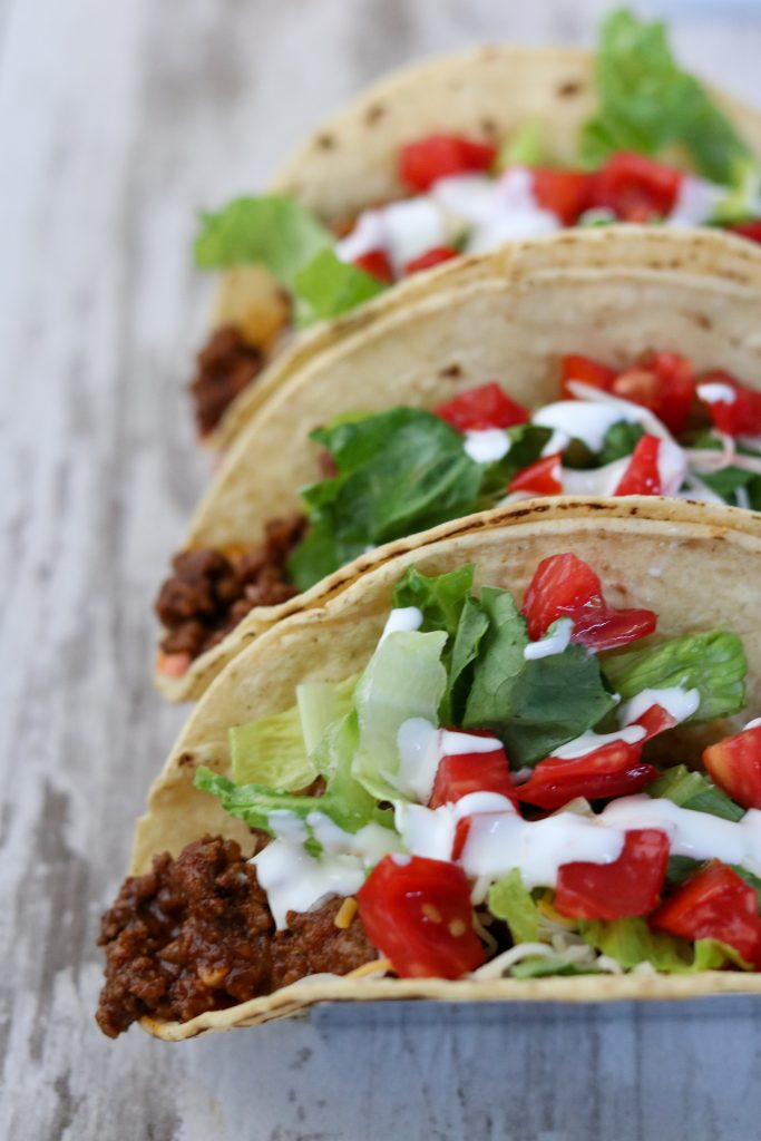 A close up of tacos with toppings