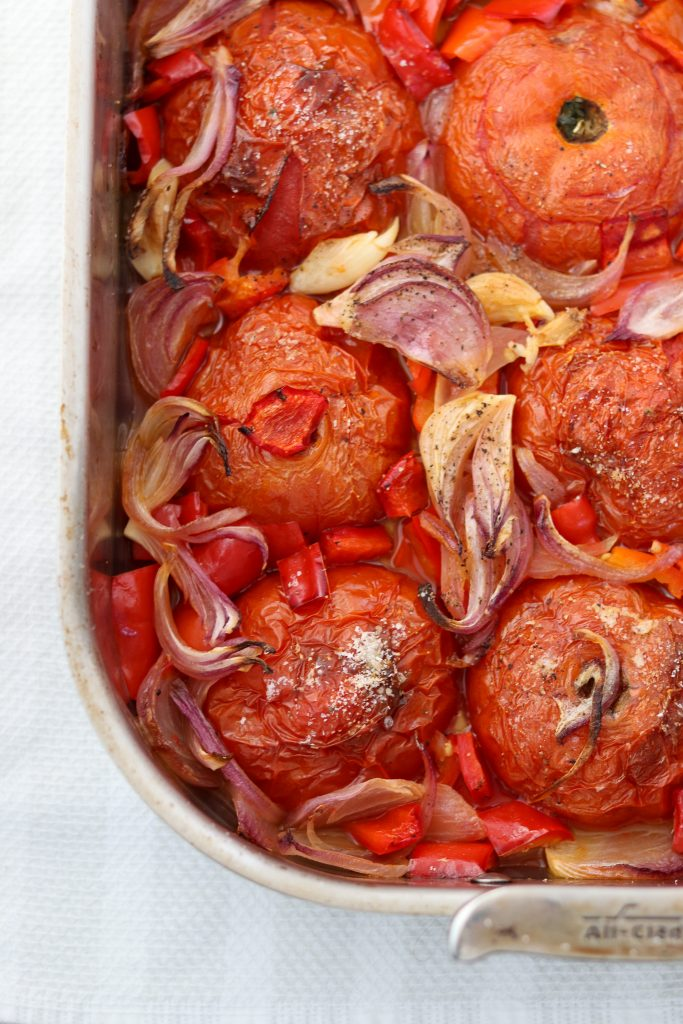 Roasted tomatoes, onions, garlic and red peppers in a pan