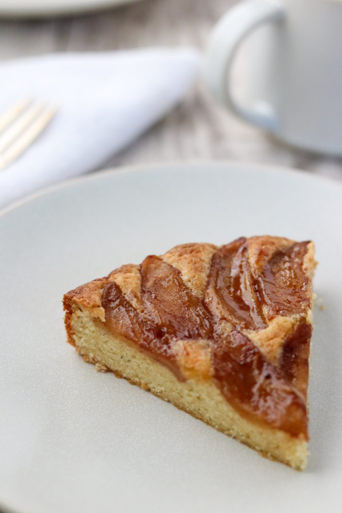 A slice of Swedish apple cake on a plate