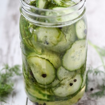 A close up of fresh pickled cucumbers in a jar