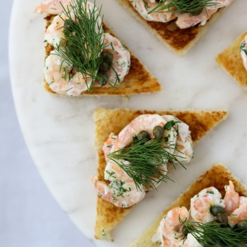 Shrimp salad on toast on a plate