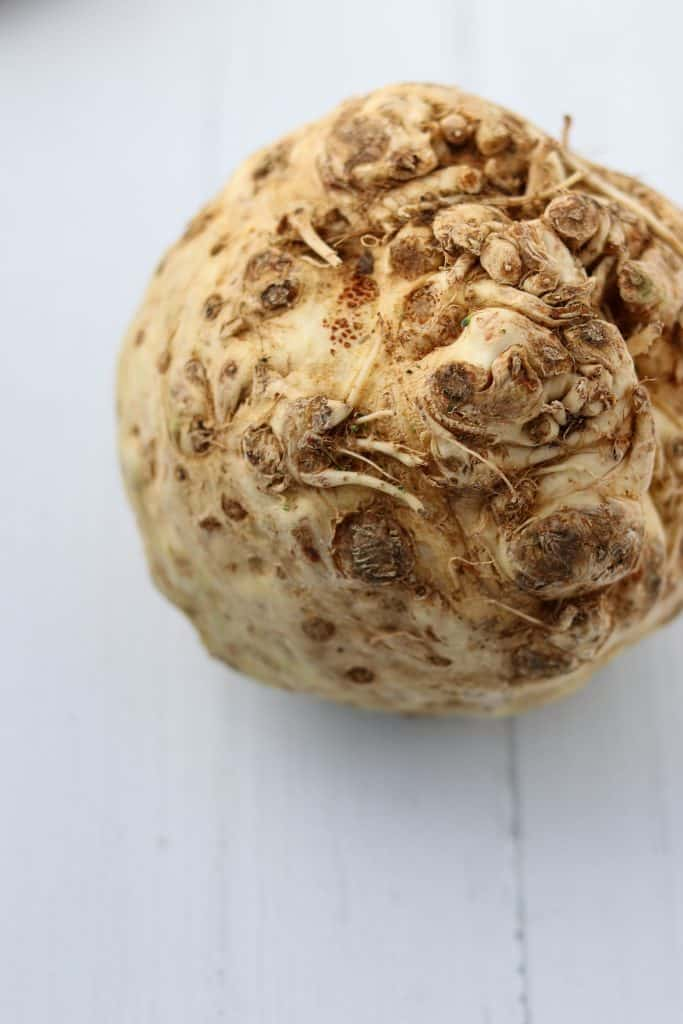 A close up of a celery root