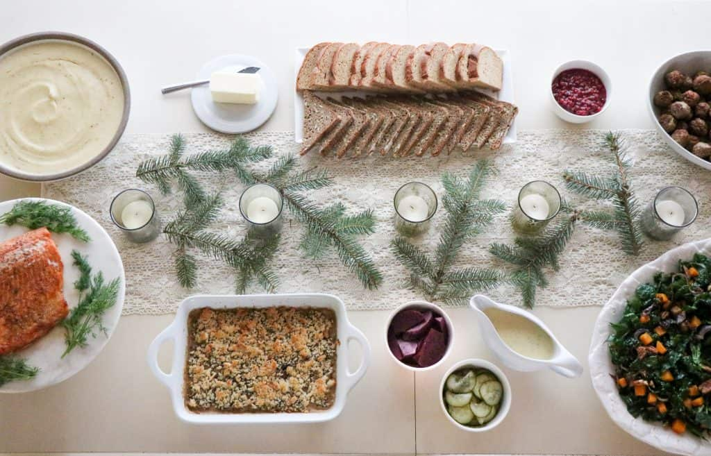 A table topped with food for a Scandinavian Christmas Eve smörgåsbord