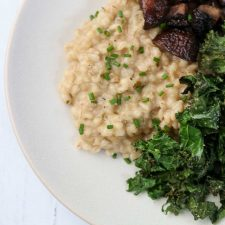 Barley risotto, roasted mushrooms and kale on a plate