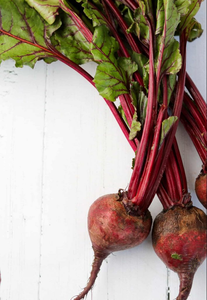 Fresh beets on a wooden surface