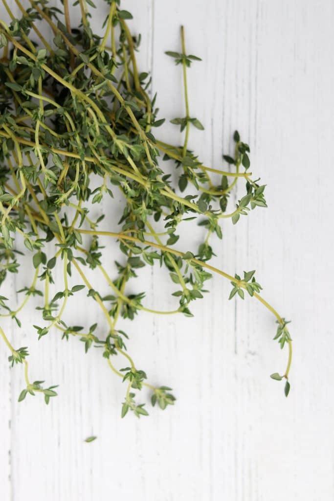 Fresh thyme on a wooden surface