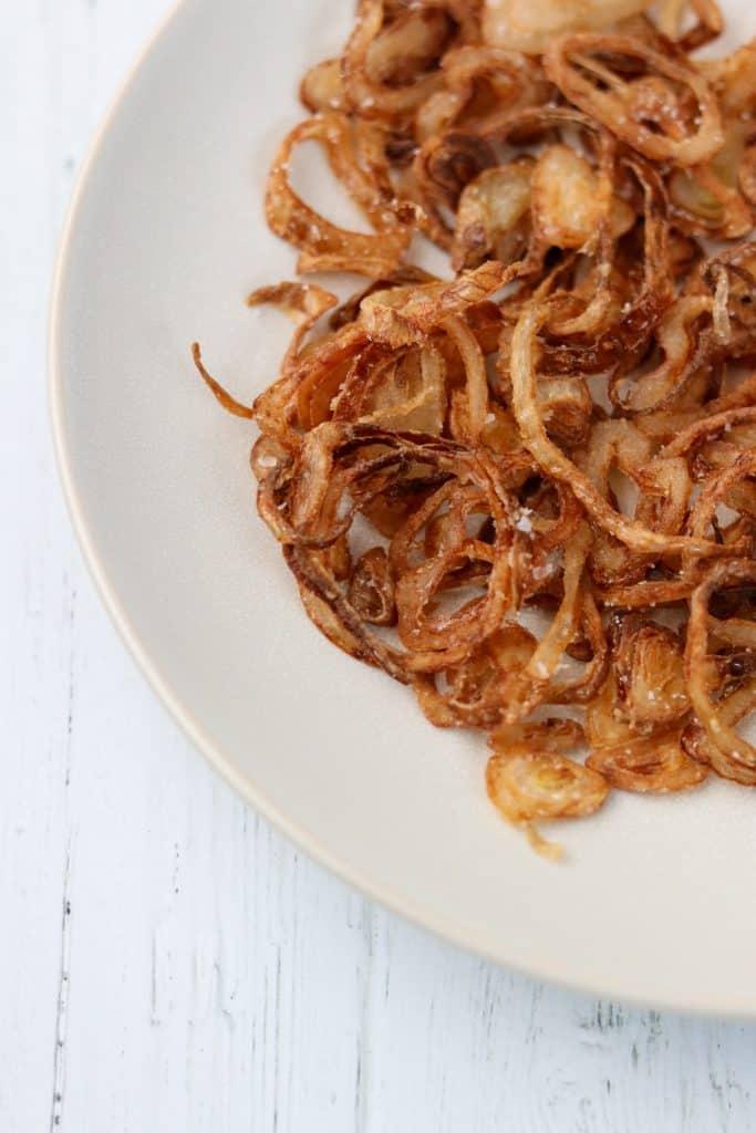 Crispy shallots on a plate