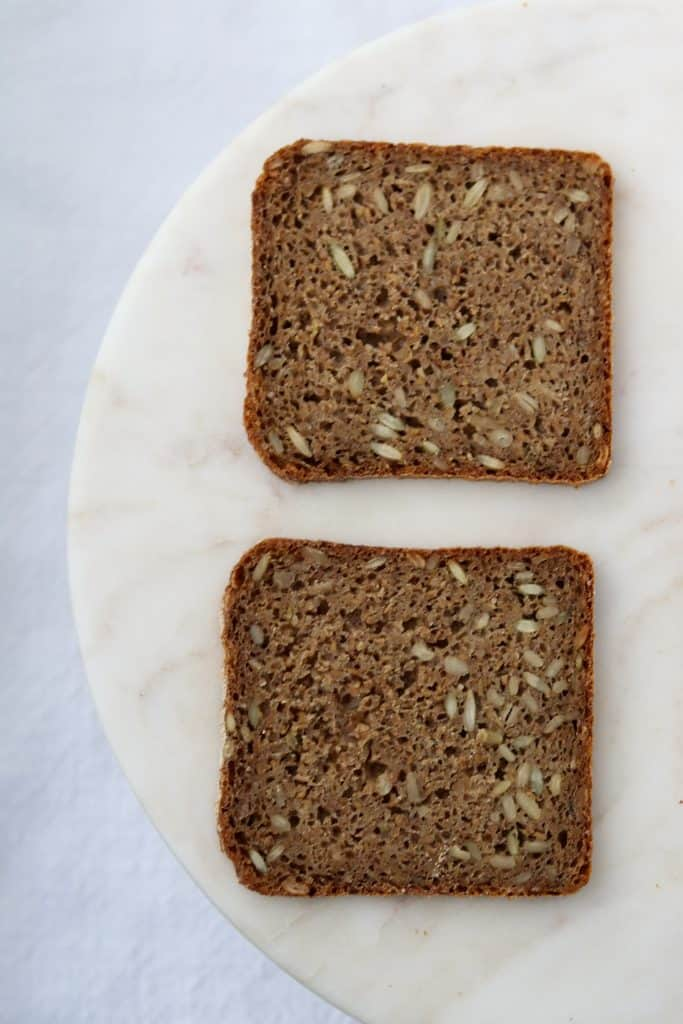 Two pieces of rye bread on a plate