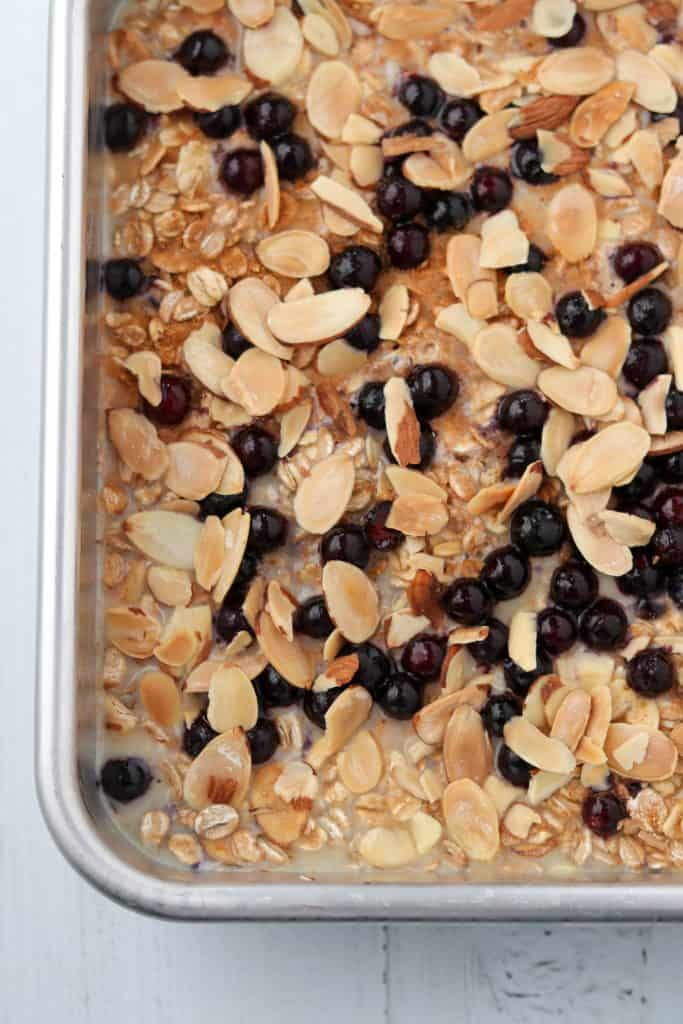 Unbaked oat and rye porridge with almonds and blueberries in a pan