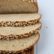 Sliced oat bread on a wooden surface