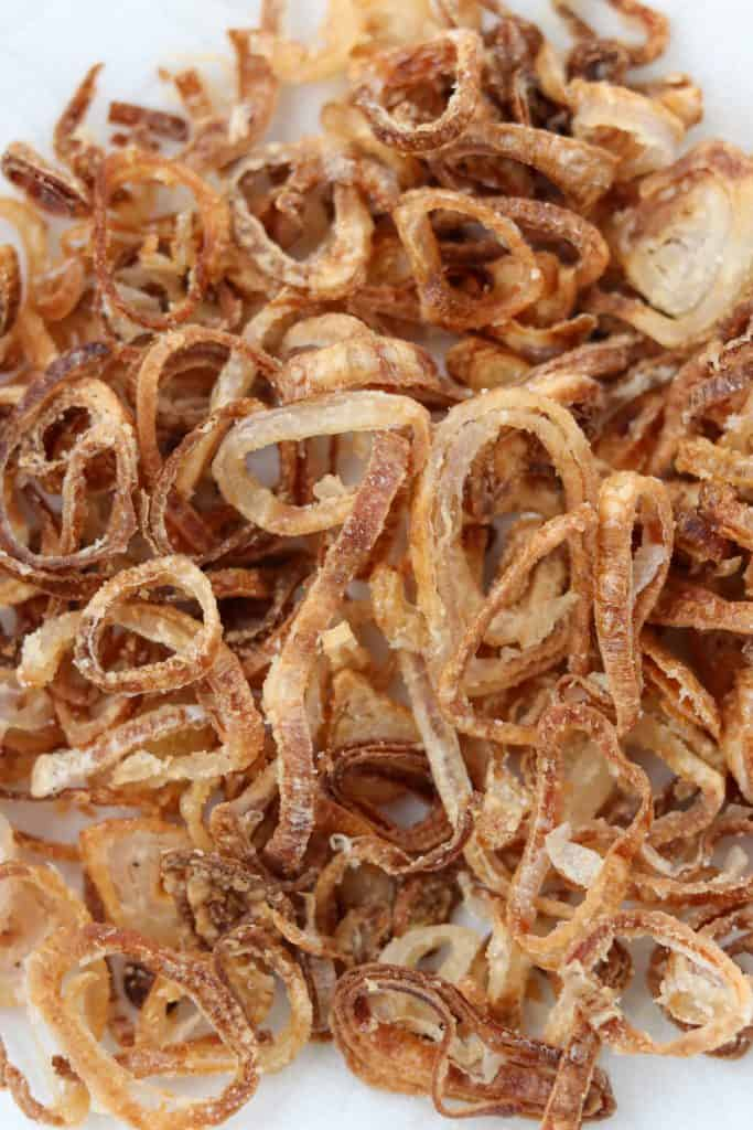 A close up of a pile of crispy shallots