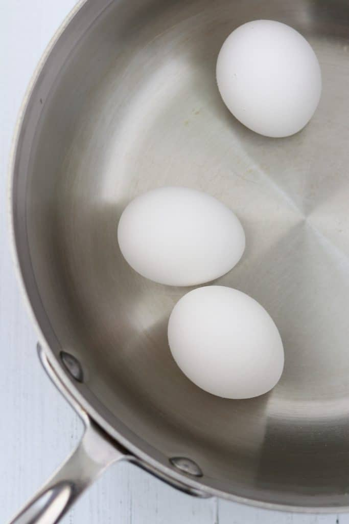 Three eggs in a saucepan