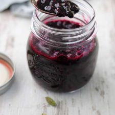 Blueberry compote in a jar with a spoon