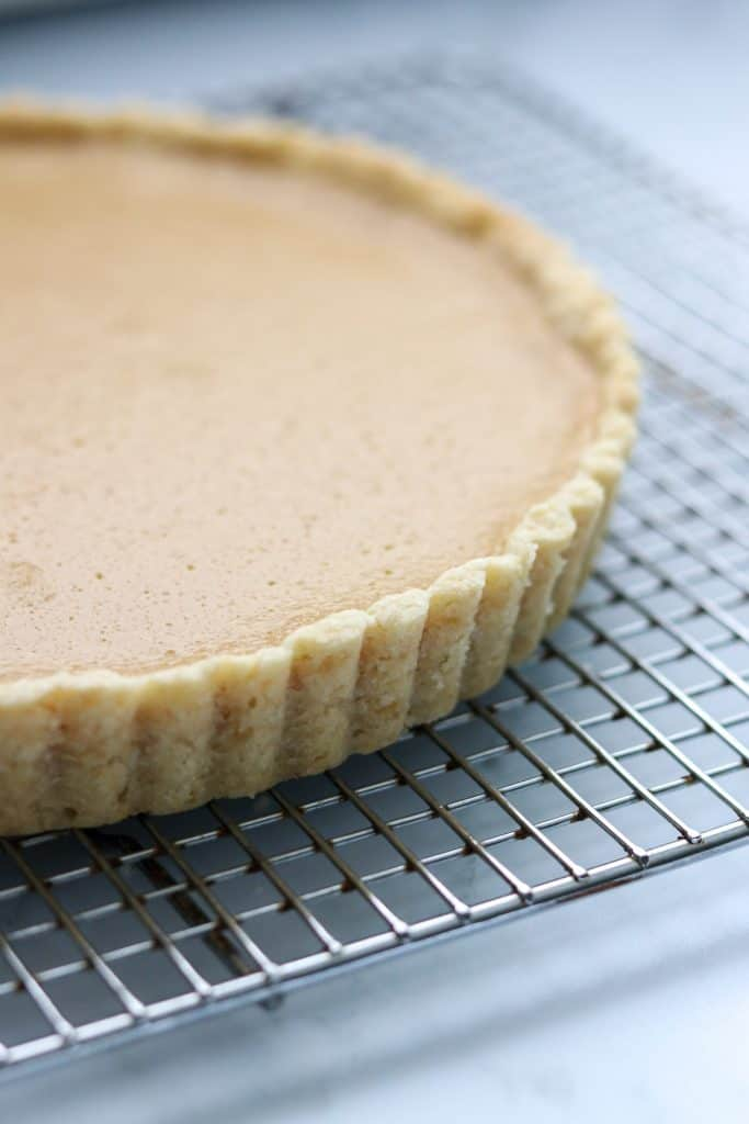A close up of a brown sugar skyr tart on a cooling rack