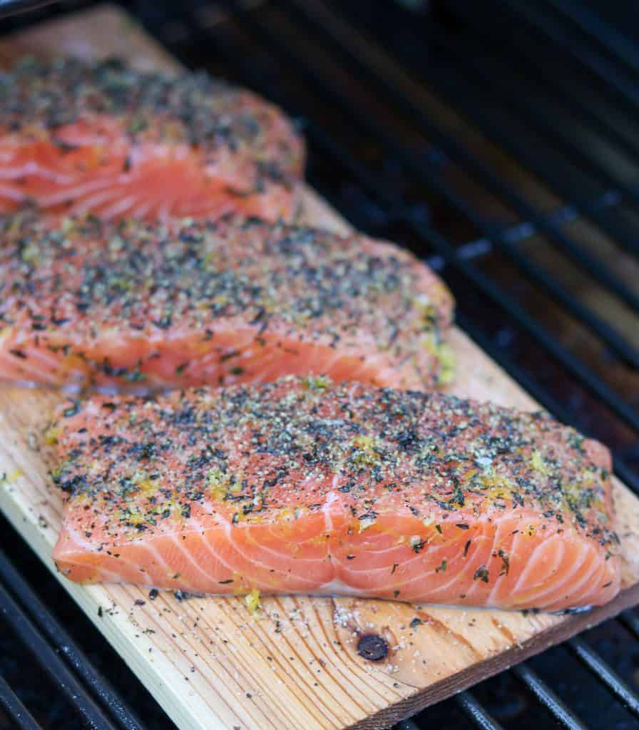 Salmon filets on a cedar plank on the grill