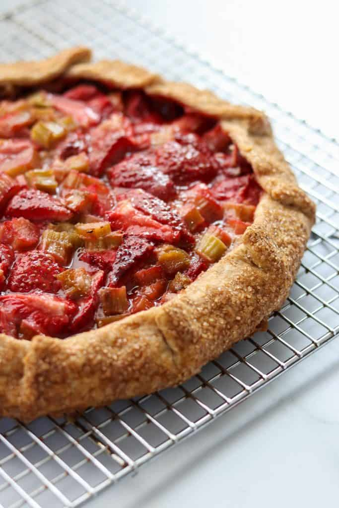 Strawberry rhubarb galette on a cooling rack