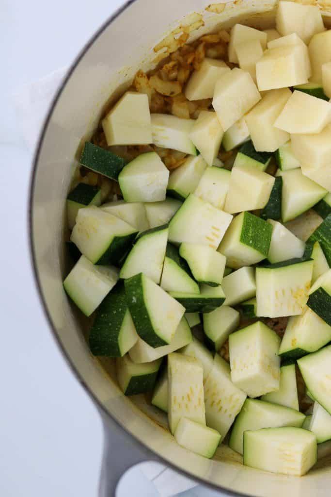 A close up of cut up zucchini and potato