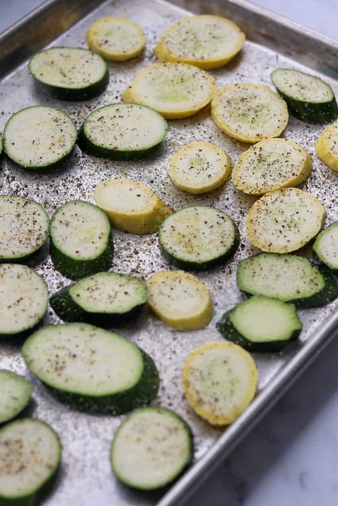 Sliced summer squash on a sheet pan