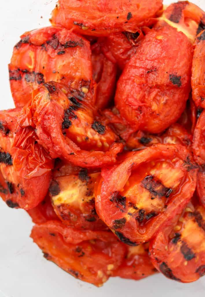 A close up of grilled tomatoes