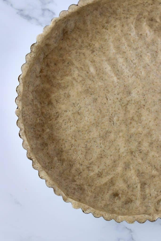 A close up of a tart shell