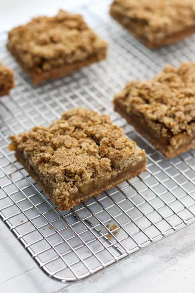 Apple Crumble Bars with Oats and Rye on a cooling rack
