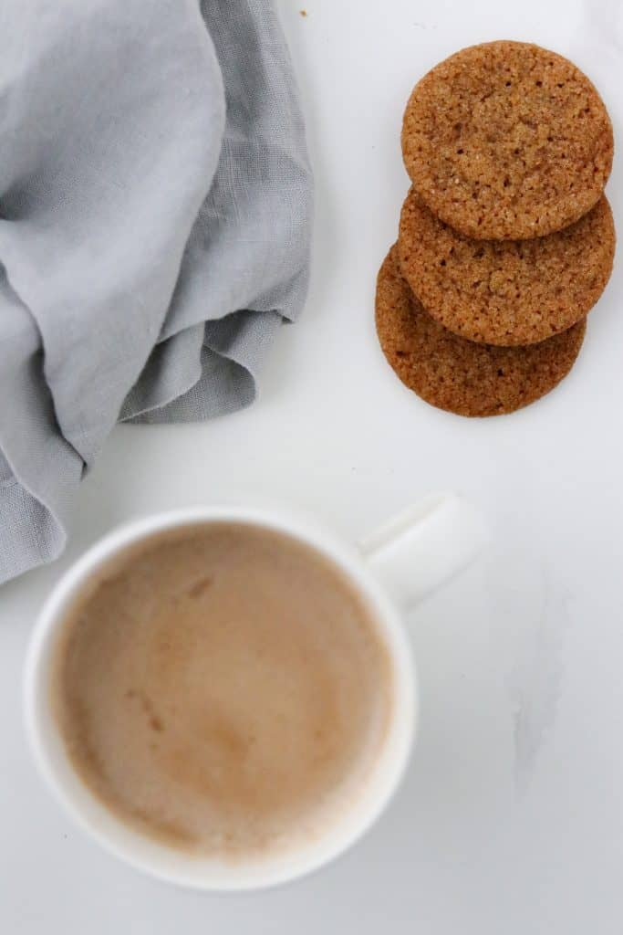 Pumpkin Spice Latte in a mug with gingersnaps