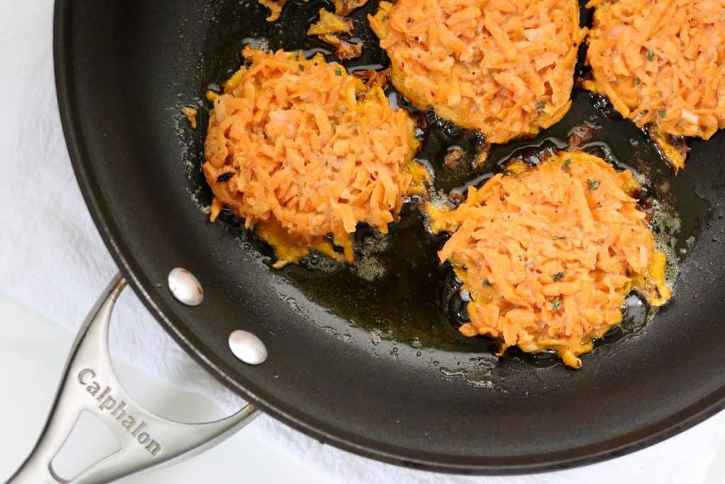 Sweet Potato Pancakes cooking in a pan