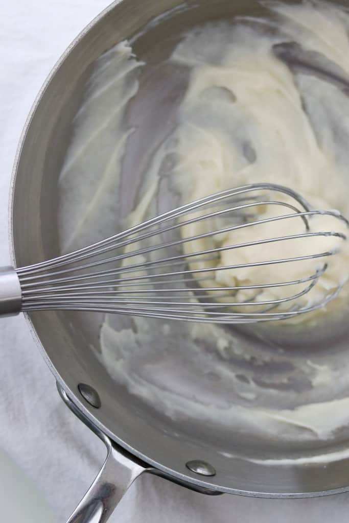 Mixture of water, milk and flour cooked in a pan with a whisk