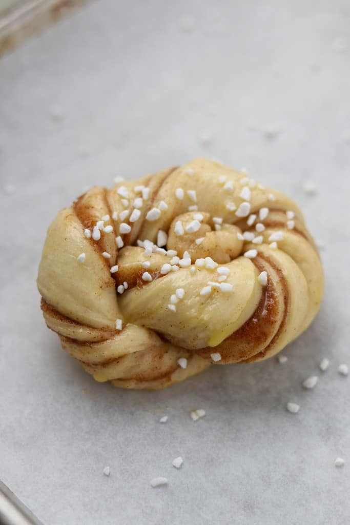 A close up of an unbaked cinnamon bun
