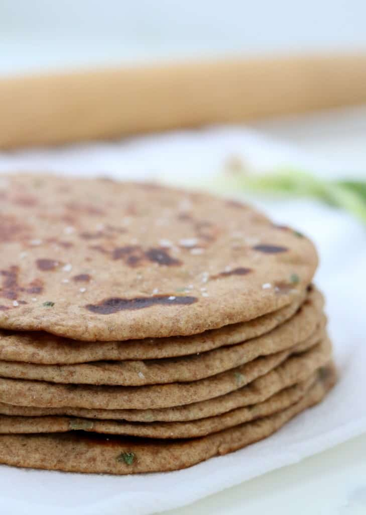 Close up of stack of flatbreads with a rolling pin