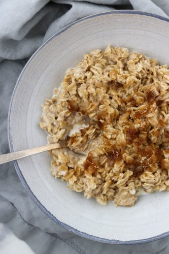 Oatmeal in a bowl with a spoon on a napkin