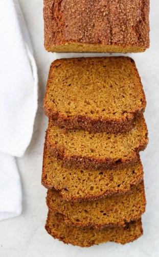 Slices of pumpkin bread next to a towel