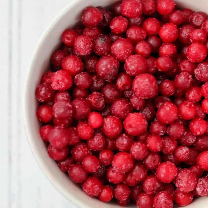 Frozen lingonberries in a bowl.