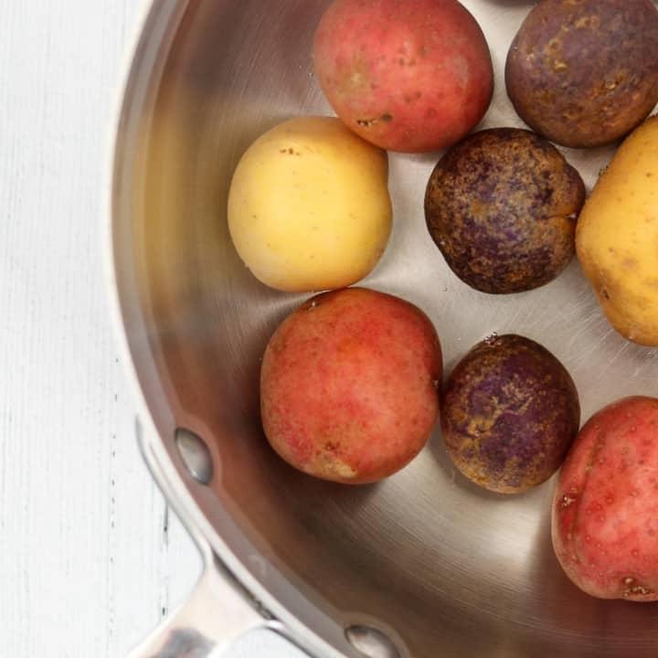 Potatoes in a metal pan.