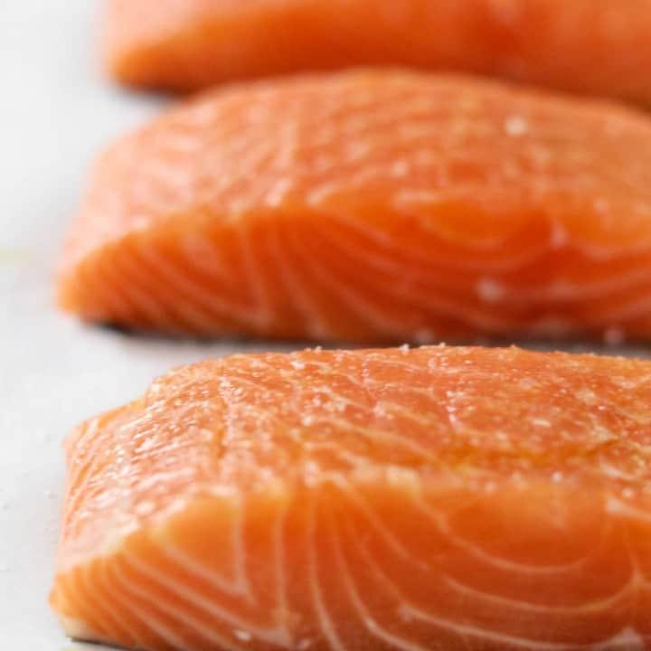 Close up of raw salmon filets.