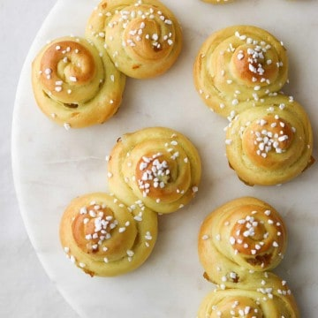 St. Lucia Buns on a marble plate.