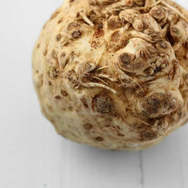 celery root on a white wooden surface.