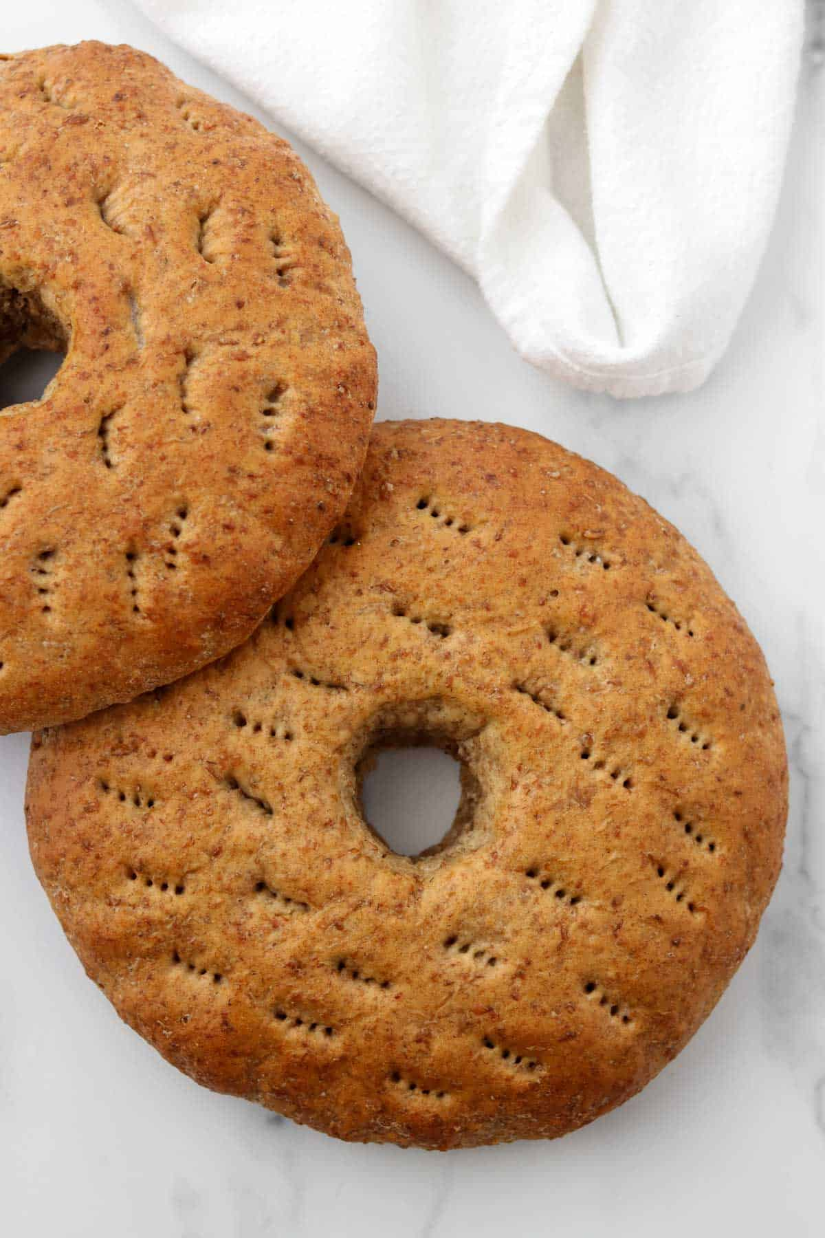 Finnish rye bread rings on a marble surface.
