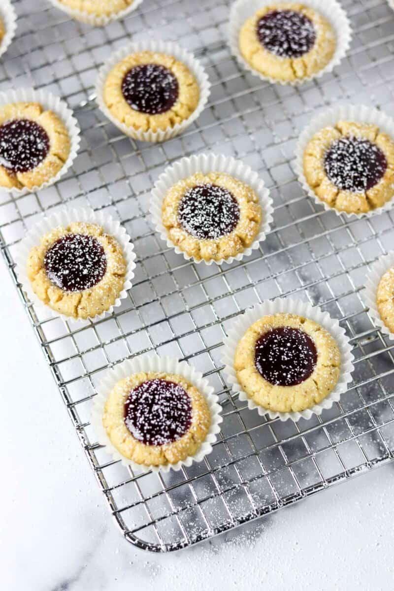Raspberry hazelnut thumbprints on a cooling rack.