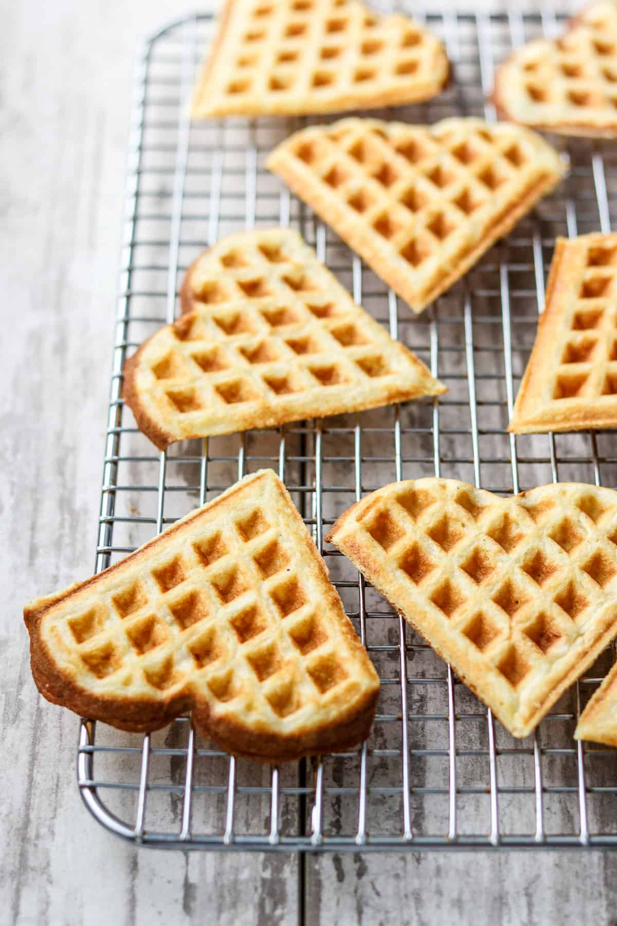 Heart shaped waffles on a cooling rack.