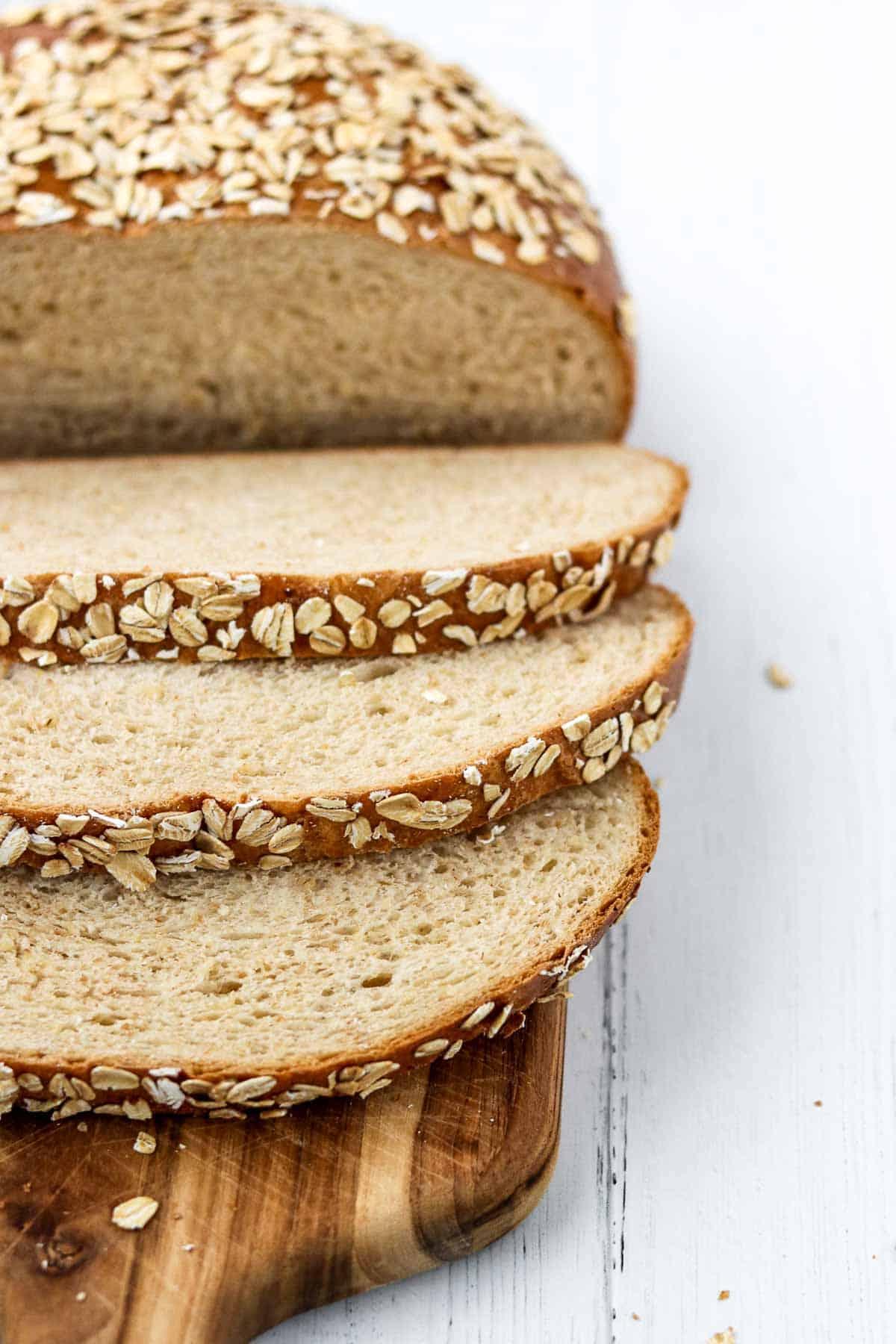Danish oat bread sliced on a cutting board.