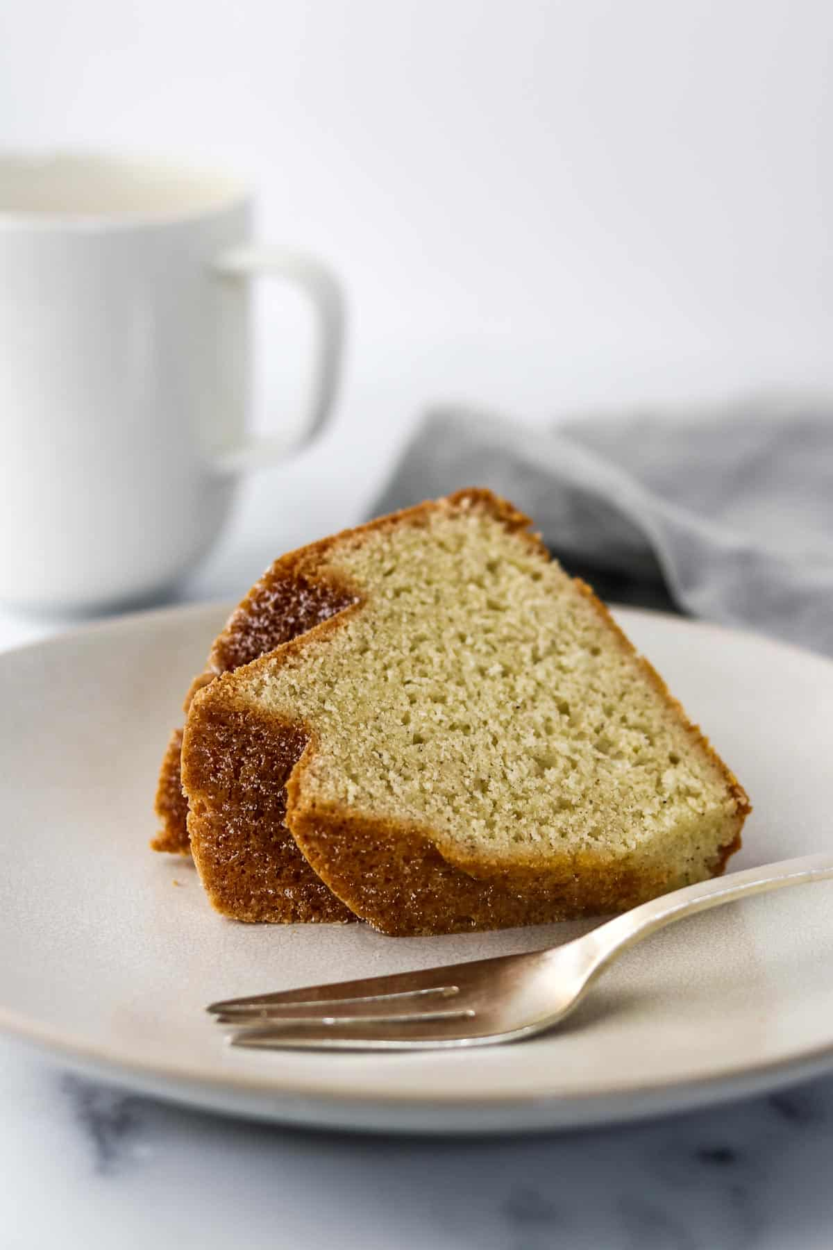 Slice of bundt cake on a plate with a fork.