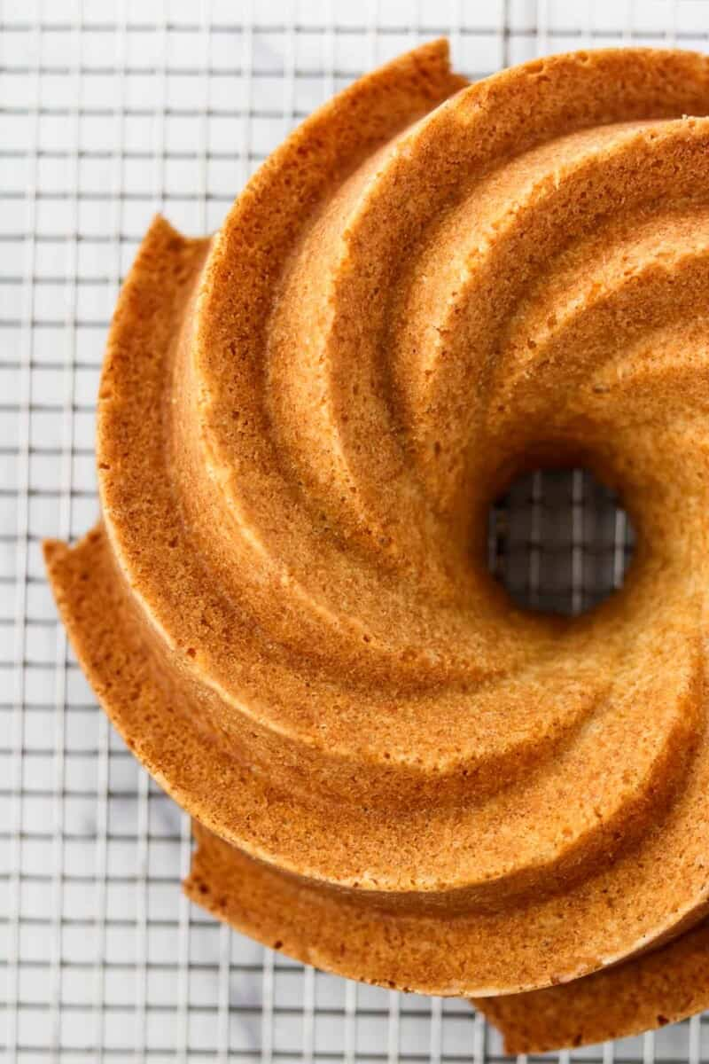 Overhead view of a bundt cake on a wire rack.